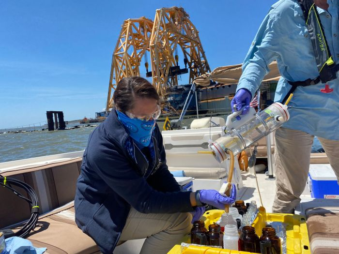 Response personnel collect water samples in the vicinity of the Golden Ray wreck on Saturday