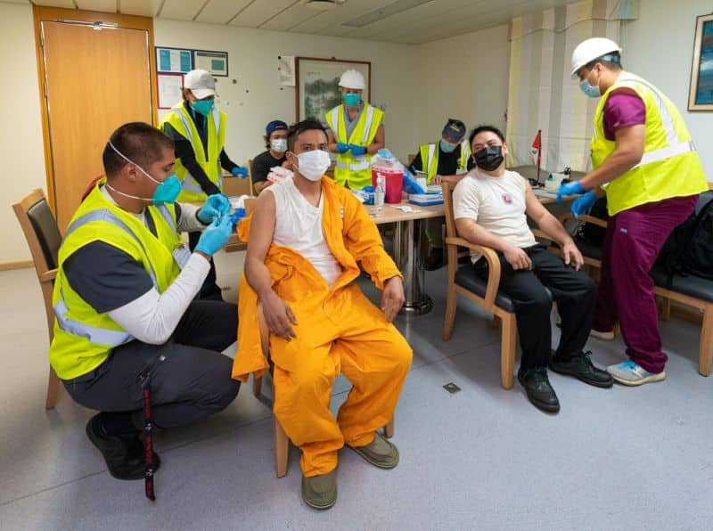 Crew members of a ship docked at the Port of Long Beach receive the Johnson & Johnson COVID-19 vaccine on May 27, 2021.