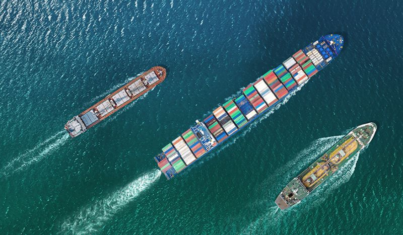 container ships sailing top down view